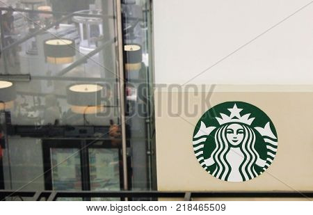 ST. PETERSBURG, RUSSIA - DECEMBER 9, 2017: Starbucks Coffee Logo Inside the Store. Starbucks is an American Coffee Company and Coffeehouse Chain, Founded in 1971. Brand Logo on Empty Wall Copyspace.