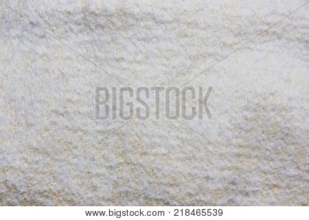Grunge Cloth Texture of Dirty White Wool Material Background. Seamless Abstract Clothing Pattern Design with Worn Out Wool Sweater Detail Close Up. Fabric Empty Surface Backdrop for Copy Space.
