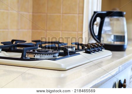 gas hob cooking with four burners for cooking. poster