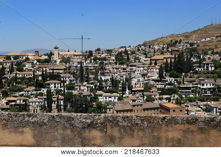 GRANADA, SPAIN - MAY 20, 2017: Albaicin is a residential district the architecture and planning of which are inherited from the Muslim period of medieval Spain.