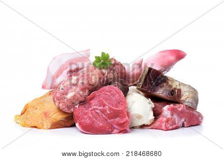 closeup of some uncooked pieces and products of chicken, beef and pork meat to prepare escudella, a soup typical of Catalonia, Spain, on a white background