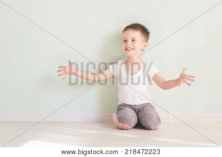 Happy cute child reaching out his palms and catching something. Funny teenager trying to catch something, isolated