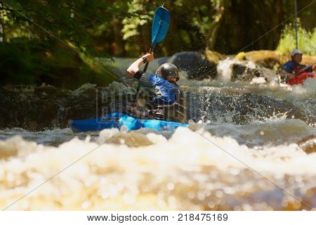 Frongoch Wales UK - June 18 2017: White water kayaker shooting the rapids at the National White Water Centre on the River Tryweryn in Snowdonia National Park