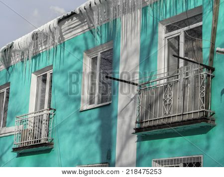 Old turquoise building. Old apartment building. Architectural heritage. Old architecture
