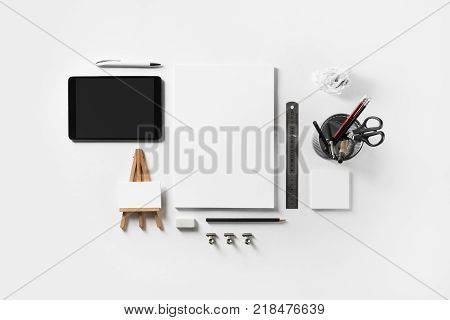 Photo of blank stationery. Corporate identity template on white paper background. Mock up for design portfolios. Flat lay.