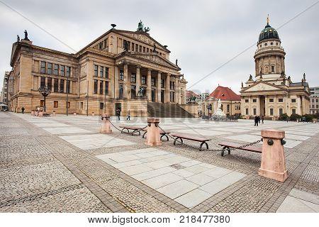 Deutscher Dom on Gendarmenmarkt, with the monument of Friedrich Schiller in the foreground. Berlin, Germany