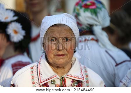 Belarus Gomel May 20 2017.Belarus Gomel May 20 2017. Holiday in the branch of the Vetkovsky Museum.Old woman in scarf and national clothes.Belarusian grandmother. Old Slavs
