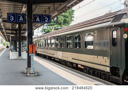 Locarno Switzerland - May 28 2016: A passenger train of the Swiss Federal Railways at a platform of the Locarno railway station. Swiss Federal Railways is the national railway company of Switzerland