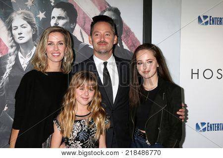 LOS ANGELES - DEC 14:  Jocelyne Cooper, Stella Cooper, Scott Cooper, Ava Cooper at the
