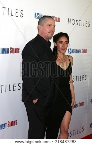 LOS ANGELES - DEC 14:  Christian Bale, Q'Orianka Kilcher at the