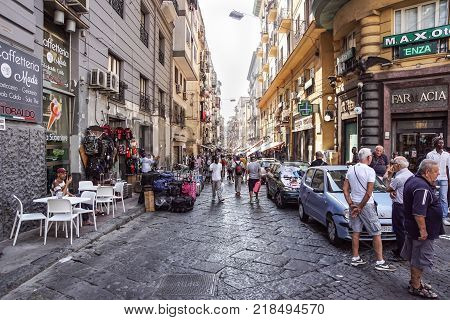 NAPLES, ITALY - AUGUST 22: Porta Nolana Market in Naples on AUGUST 22, 2017. Local People Shopping at Sunday Street Market in Napoli, Italy