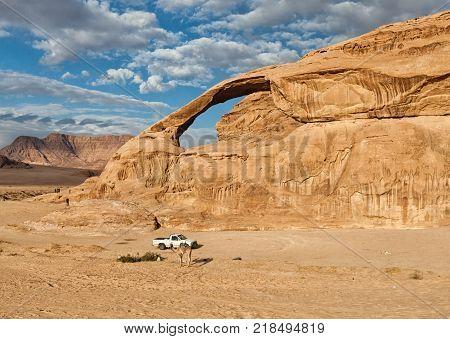 a car in the desert of wadi rum
