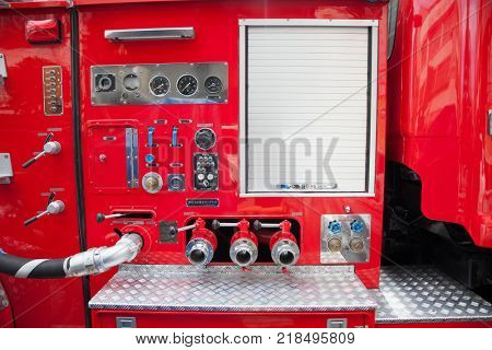 HONG KONG -APR 1, 2016: Fireman fire truck hose faucets in a row red and silver on Apr 1, 2016. Hong Kong.