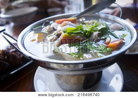 Thai spicy food. Tom yum or tom yam is a type of hot and sour Lao and Thai soup. Tom yum have origin in Laos and Thailand.