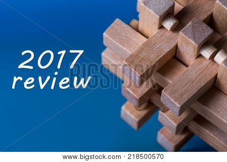 2017 Review,- Time to summarize and plan goals for the next year. Business background with wooden brain teaser.