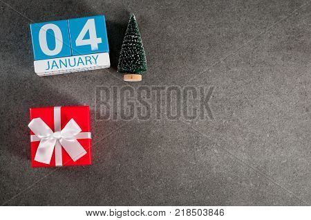 January 4th. Image 4 day of January month, calendar with x-mas gift and christmas tree. New year background with empty space for text, mockup.