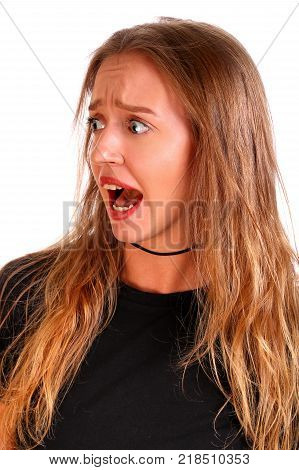 Screaming teenager girl isolated over white background
