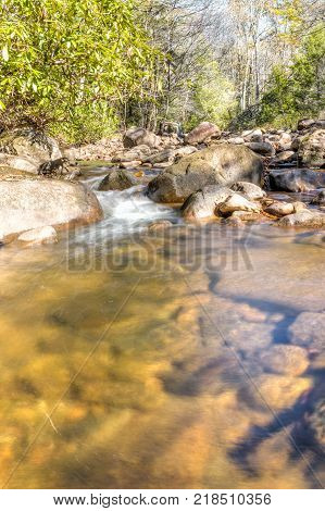 Williams River In Autumn With Stones, Bridge And Highland Scenic Highway Road In West Virginia Monon
