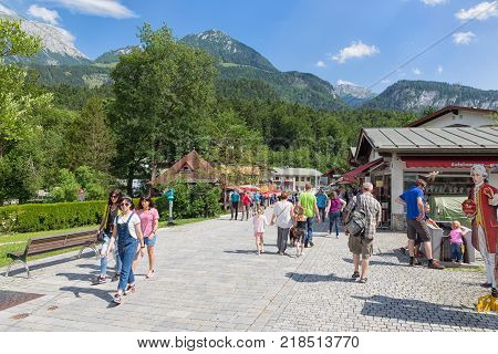 BERCHTESGADEN, GERMANY - JULY 08, 2017: People in shopping street of tourist resort Schonau am Konigssee near Berchtesgaden