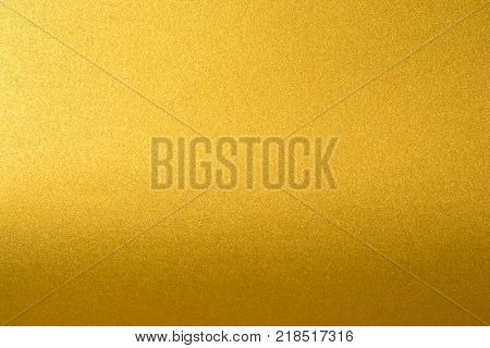 Details of golden texture background with gradient and shadow. Gold color paint wall. Luxury golden background and wallpaper. Gold foil or wrapping paper