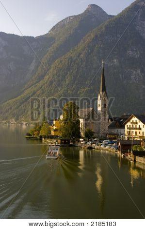 Boat Docking In Serene Hallstatt, Austria