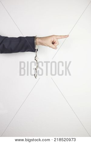 handcuffs for businessman going to jail. justice - concept. male hands in handcuffs isolated on white background.