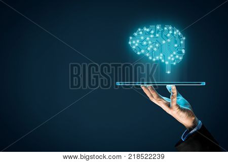 Artificial intelligence (AI), machine deep learning, data mining and another modern computer technologies concepts. Brain representing artificial intelligence and businessman holding futuristic tablet.