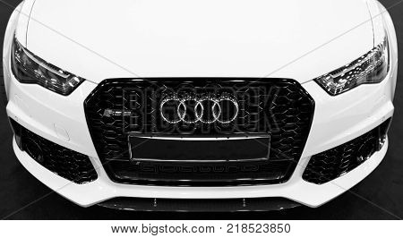 Sankt-Petersburg Russia July 21 2017: Front view of a blue modern luxury blue sport car Audi RS 6 Avant Quattro 2017. Car exterior details. Black and white.