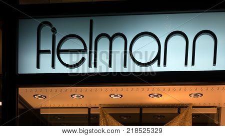 GIESSEN GERMANY DECEMBER 2017: Illuminated Logotype of FIELMANNl. FIELMANN is a glasses provider chain based in Hamburg.
