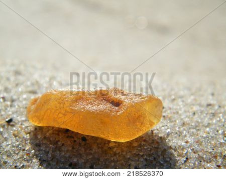 A piece of amber on the seashore; the Curonian spit