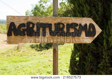 Handmade wooden agriturismo sign in Tuscany - agritourism is a typical concept of bed and breakfast in a farming environment in Italy.