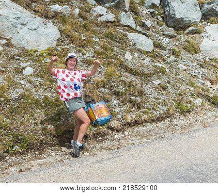 Col de la Croix de Fer France - 25 July 2015: Unidentified woman fan in a Polka Dot Jersey is very happy on the road to the Col de la Croix de Fer in Alps during the stage 20 of Le Tour de France 2015.
