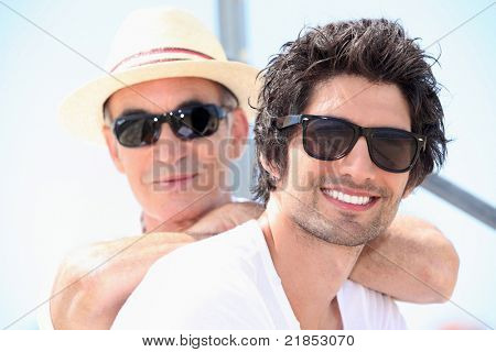 Father and son wearing sunglasses