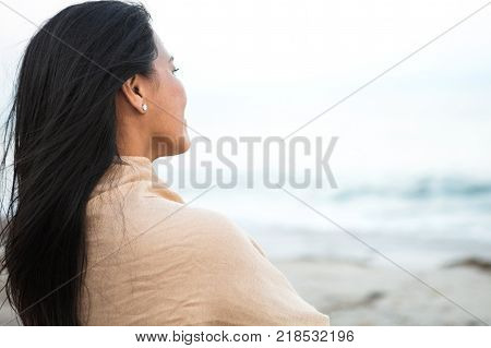 Beautiful confident Asian woman standing on the beach.