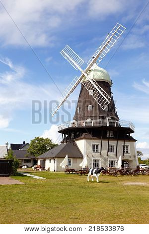 Sandvik Sweden - August 22 2017: Sandvik windmill is the largest smock mill in Oland and is also considered Northern Europe's largest windmill. Well visible far away it has become a landmark and symbol for Sandvik.