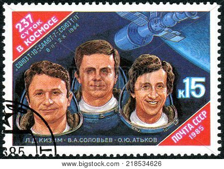USSR - CIRCA 1985: A stamp printed in USSR dedicated to 237 Days in Space shows a Cosmonauts Leonid Kizim Vladimir Solovyov Oleg Atkov and Salyut-7 Spacecraft circa 1985
