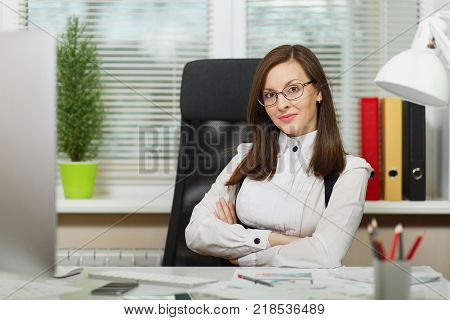 Brown-hair Business Woman In Suit Sitting At The Desk, Printing Hands On The Keyboard, Working At Co
