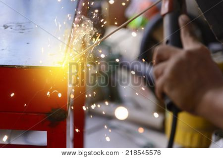 The electric welding process.Arc welding process with the lighting effect