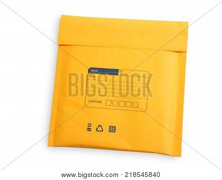 Yellow letter envelope with air bubble wrap for cd and dvd isolated over white background clipping path.