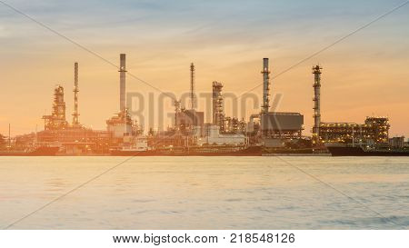 Industrial oil refinery plant river front heavy industrial background sunset tone