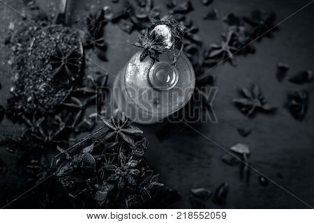 Close Up Star Aniseed,illicium Verum In A Bowl With Powder And Its Oil.