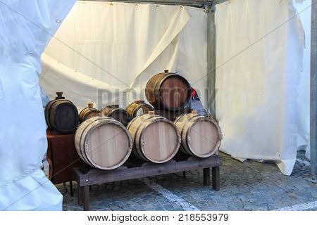 New wooden barrels under the white tent