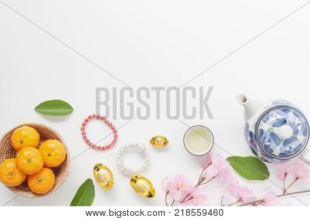 Table top view aerial of accessories and Chinese new year and Lunar new year festival concept background.Decorations for festive in holiday.Difference items on modern white wooden at home office desk.