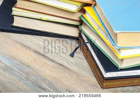 Old colorful books on the table.Copy space for text.Back to school. Education background.