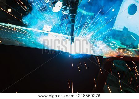 Welding Sparks and smoke from robot welding in manufacturing