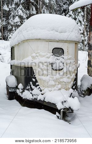 A horse trailer covered in white snow