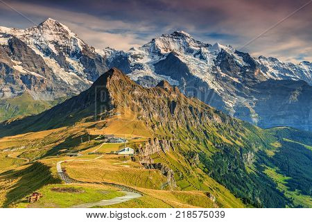 Stunning alpine panorama with Jungfrau, Monch, Eiger North face and Mannlichen cable car station, Grindelwald, Bernese Oberland, Switzerland, Europe