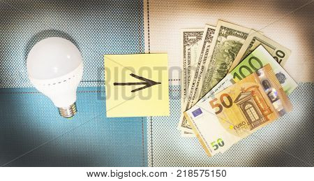 Energy-saving lamps and money the concept of frugality.