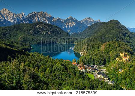 Stunning alpine landscape with glacier lakes, high mountains and Hohenschwangau castle near famous Neuschwanstein castle, Bavaria, Germany, Europe