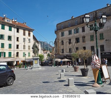 France, Corse, Corte, June 21, 2017, Main Square In Corte City In Summer With Old Houses Statue And
